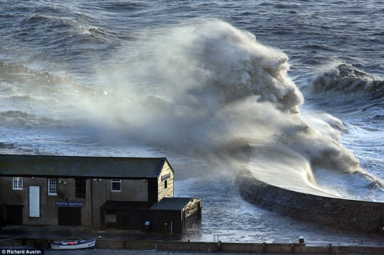 Unusual sight: The uncanny shape of a large white horse jumping over the Cobb Wall at Lyme Regis in Dorset Read more: http://www.dailymail.co.uk/news/article-2534113/Aerial-views-shocking-scale-flooding-damage-Britain.html#ixzz2pjjxzdAZ Follow us: @MailOnline on Twitter | DailyMail on Facebook