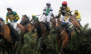 Pineau de Re, ridden by Leighton Aspell, on his way to winning the Grand National (center)