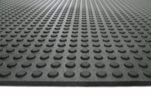 This mat features a button-covered surface that provides more traction.