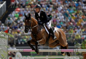 Michael Jung, of Germany, riding Sam Fbw, competes in the equestrian eventing team show jumping phase at the 2016 Summer Olympics in Rio de Janeiro, Brazil, Tuesday, Aug. 9, 2016. (AP Photo/John Locher)